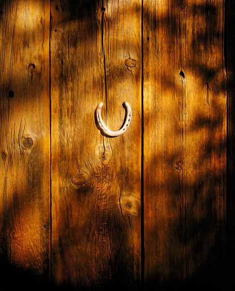 Horseshoe on Wood Panels --- Image by © Chris Collins/Corbis