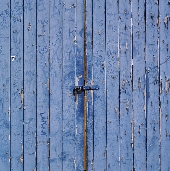 Worn blue door --- Image by © Image Source/Corbis