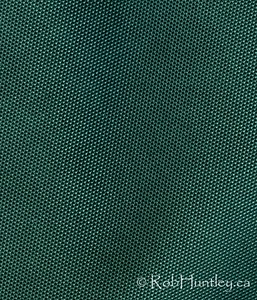 Green canvas. Dark green canvas close-up. © Rob Huntley