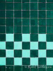 Checkerboard in turquoise. Turquoise painted cinder blocks make a checkerboard pattern. © Rob Huntley