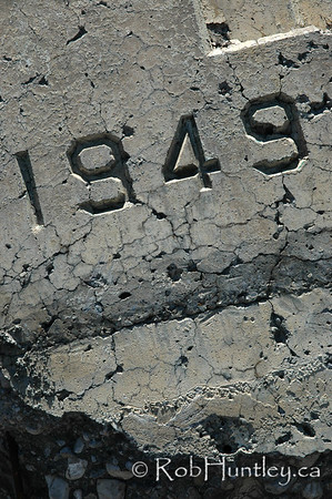 1949 - year engraved in broken concrete slab.  © Rob Huntley