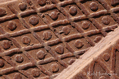 Close-up detail of the rusty bucket of an antique digger bulldozer.  © Rob Huntley