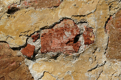 Detail texture of a repaired wall in Oaxaca, Mexico.