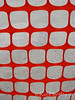 Abstract image of an orange snow fence pattern against a concrete walkway.<br /> <br /> © Rob Huntley