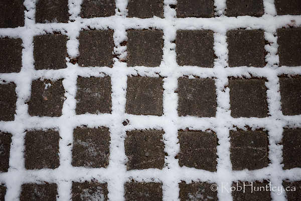 First snow on concrete paving stones. Settling between the cracks.  © Rob Huntley