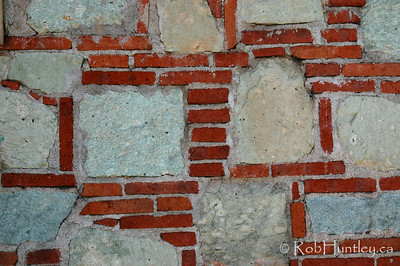 Brick and stone. Red brick and grey stone wall in Oaxaca, Mexico. © Rob Huntley