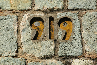 Inset House Numbers on a stone wall in Oaxaca, Mexico.