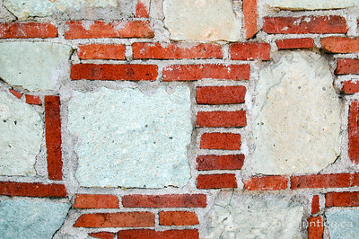 Wall of a stone building in a street in Oaxaca, Mexico.  © Rob Huntley