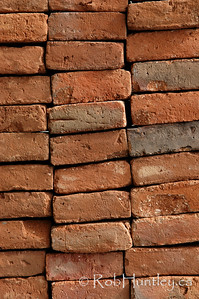 Building bricks stacked on end in a pile. Huatulco, Mexico. This and the adjacent image are the same but with different orientations.  © Rob Huntley
