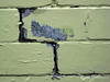 Cracks between concrete blocks and peeling yellow paint on a demolition site in Westboro, Ottawa.<br /> <br /> © Rob Huntley