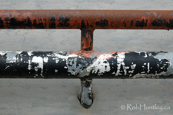 Rusty and peeling handrail.