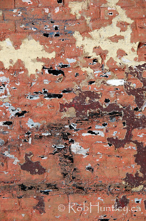 Detail of painted flaking brick wall in Oaxaca, Mexico