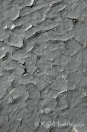 Grey paint cracking and peeling.