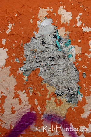 Orange wall and peeling paint.