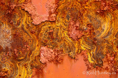 Rust Topography. Peeling pink paint and swirling rust patterns.