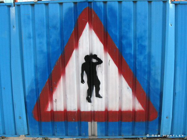 Yield to drunkards. Painted on construction perimeter fence in downtown Leeds, England.