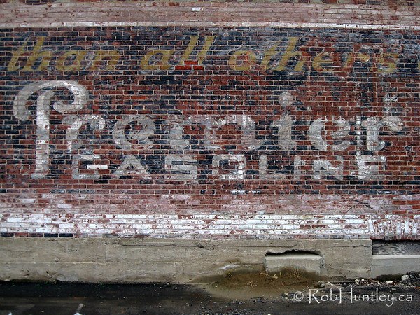 Demolitions reveals old painted signwork on a brick wall in Westboro community in Ottawa.