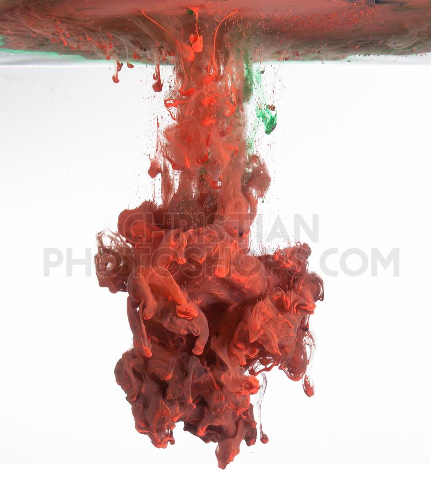 Red paint splashes under water