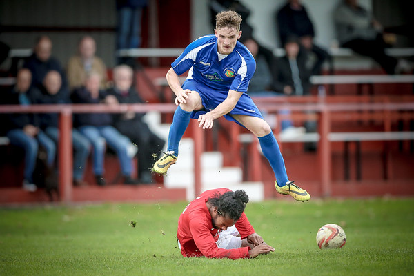 Ryan Sharrocks goes over his opponent rather than around - during Railway's 2-1 loss away to Thackley