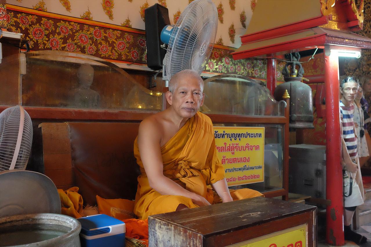 Monk who bestows water blessings