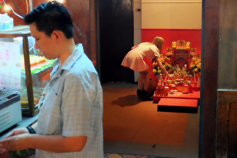 Making offerings, Thanaya Plaza. Bangkok