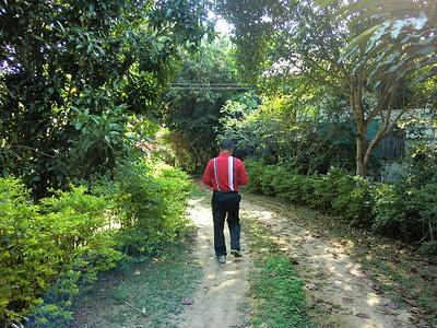 Khun Amnuay in his garden