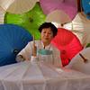 Applying paste to umbrellas. Bor Sang, Thailand
