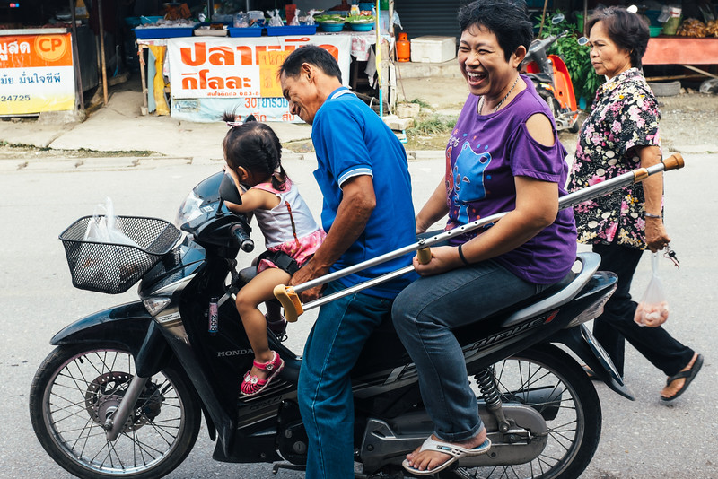 Family on scooter with crutch