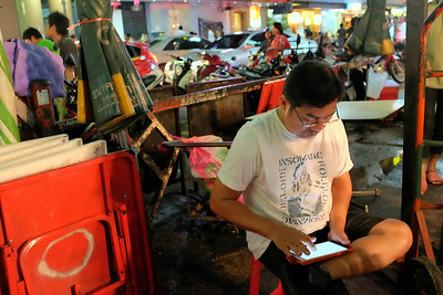 Using tablet, Thanaya Plaza, Bangkok
