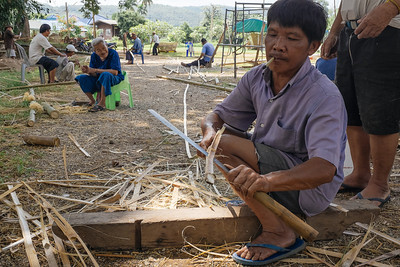 Skillfully cutting bamboo into veneer strips for use in the Bah Panee ceremony at Wat Ban Pong