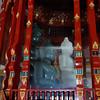 Jade (?) Buddhas behind glass