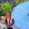Boy and blue umbrella