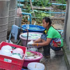 Washing dishes from busy stall