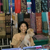 Pi Noy and dog Bee Mai sell silk