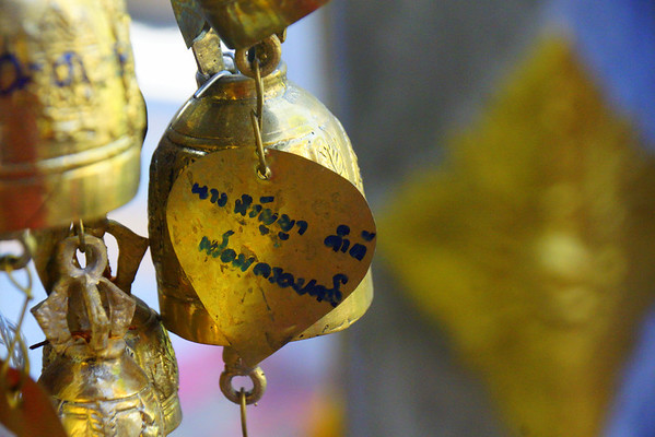 A key chain beside a golden bell at Doi Suthep Temple