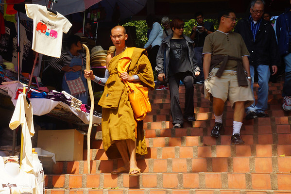 A monk walking down one of the 309 steps leading down from Doi Suthep Temple