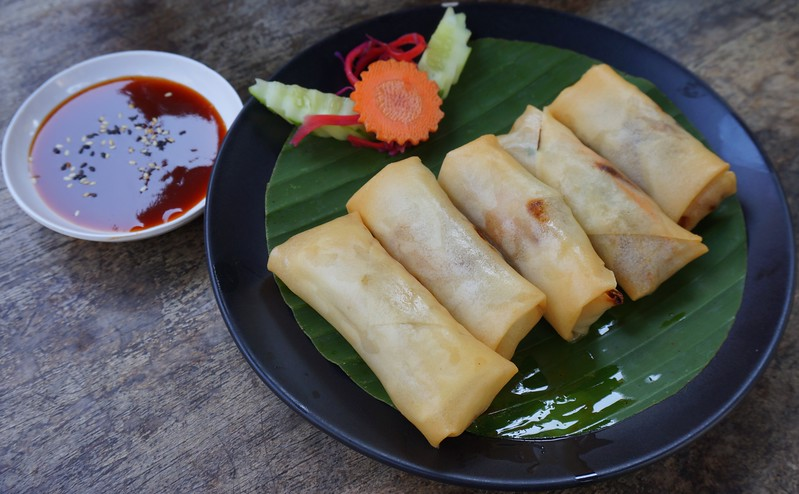 Delicious vegetarian spring rolls served for lunch at Pun Pun restaurant in Chiang Mai, Thailand.