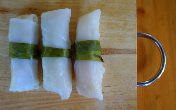 Fresh spring rolls wrapped in strips of bamboo leaf.