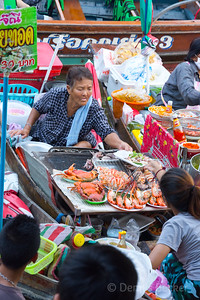 Food vendors at floating market in Amphawa