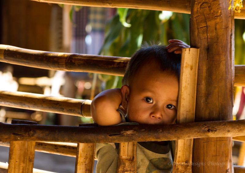 Karen Long Neck Tribe; baby in play pen