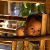 Karen Long Neck Tribe; baby in play pen