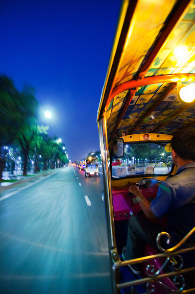 Travelling by tuk-tuk through the streets of Bangkok, Thailand. 28 march 2012.