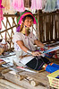 "We visited the Kayan Village in northern Thailand on 27 March 2012. Saw this lady weaving silk fabric and posing for pictures. Search ""Kayan people (Burma)"" on Wikipedia to find out more about this interesting culture. — at Long Neck Karen Village."
