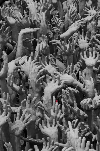 Pit of grasping hands at White Temple, Chaing Rai, Thailand. 26 March 2012.