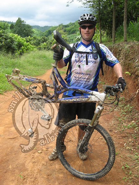 Scott showing his bike after the hanger, derailer and chain all broke.