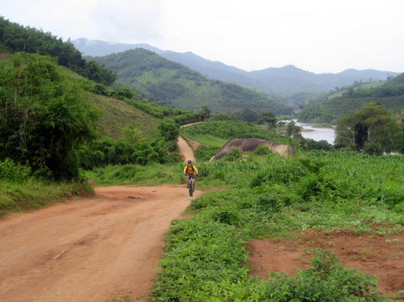 Scott pedals a dirt road from Mae Salak back to Chiang Rai province.