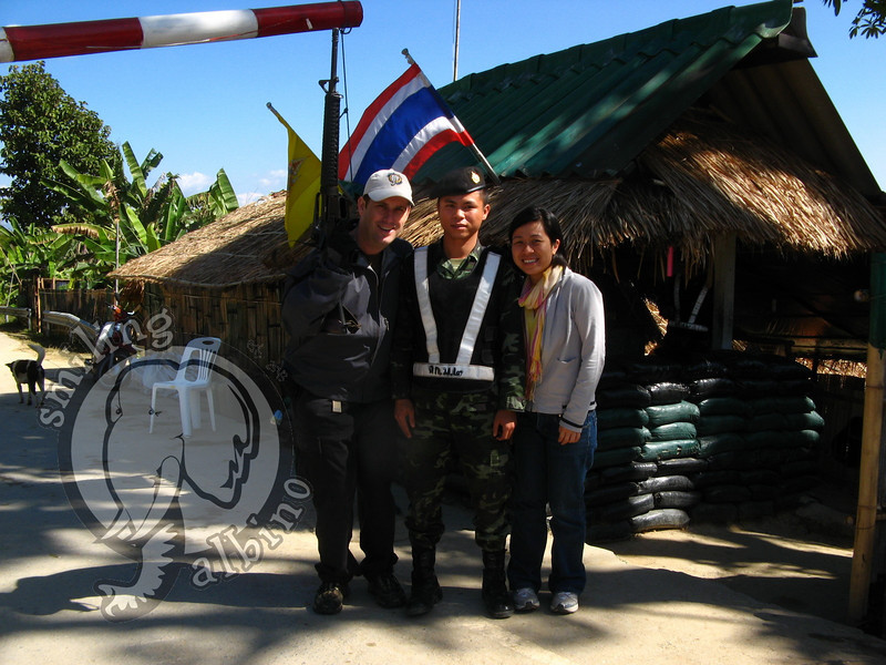 With a Thai soldier along the Thai-Myanmar border