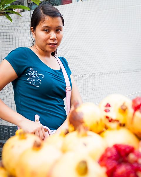 Cute street vendor with nice pomegranates