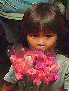 Young girl selling flowers on the streets of Bangkok. A common sight in some areas of Bangkok