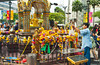 Worshipping at the buddhist Erawan shrine in downtown Bangkok, Thailand, Asia.